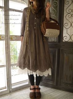 Mori, casual: Brown dress with buttons and details. Off white, lace underskirt. Black leggins. Dark brown, leather shoes. Brown basket with white details. Olive scarf.