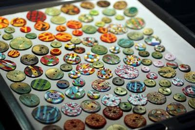buttons from polymer clay - colorful, but not durable - suitable for scrapbooking, but not everyday use in textile creations better to stick to ceramic clay for that