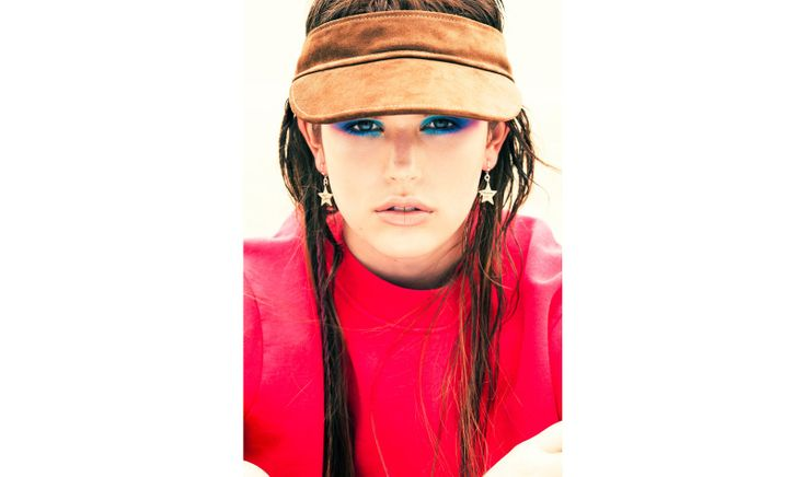 Kendell wears: Sweat shirt by Raf Simons, visor by Maison Martin Margiela and 'star' earring Atelier Serge Thoraval.