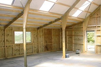 internal photo of a Customkit Barn showing portal legs and rafters