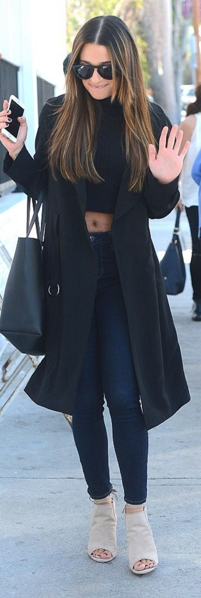 Who made  Lea Michele's black coat, ripped crop top, blue skinny jeans, and tan suede tie shoes?