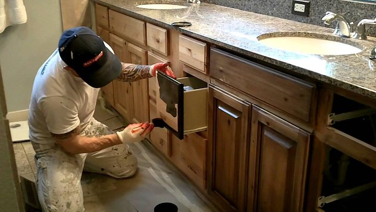 The process of using a glaze after lacquering to give an old or antiqued look to cabinets, doors, or woodwork. Using Sherwood glaze on knotty alder cabinets ...