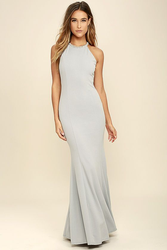 You're going to love what you see when you slip on the Girl in the Mirror Light Grey Beaded Maxi Dress! Grey stretch knit (with a blue undertone) forms a high, rounded neckline, adorned in shiny silver beads, atop a sleeveless, princess seamed bodice. Bodycon fit flares into a mermaid maxi skirt. Hidden back zipper/clasp.