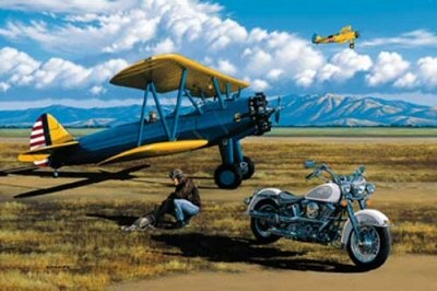 I got my dad a print of this one year. He used to fly Stearmans and used to ride a Harley. He also like the work by this artist, Stan Stokes, on display at the Palm Springs Air Museum.