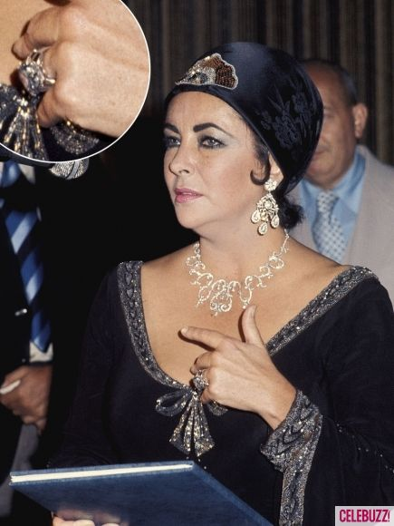 """Liz Taylor.he Mike Todd Diamond Ear Pendants    Round cut diamonds set in platinum. The original pair of these earrings were purchased on the Place Vendome-the famous Paris jewellery street. They were actually """"paste"""" but Elizabeth loved them. A few months later Mike Todd surprised Elizabeth by having the pair made up with real diamonds.  Estimate $25,000 - $35,000"""
