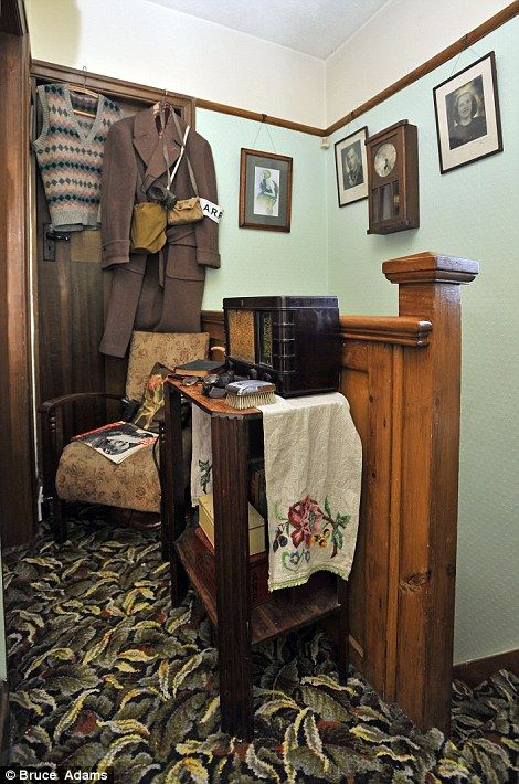 House stuck in the 1930's. On patrol: An air raid warden's outfit hangs on the landing near a Bakelite radio ideal for tuning into Churchill's speeches