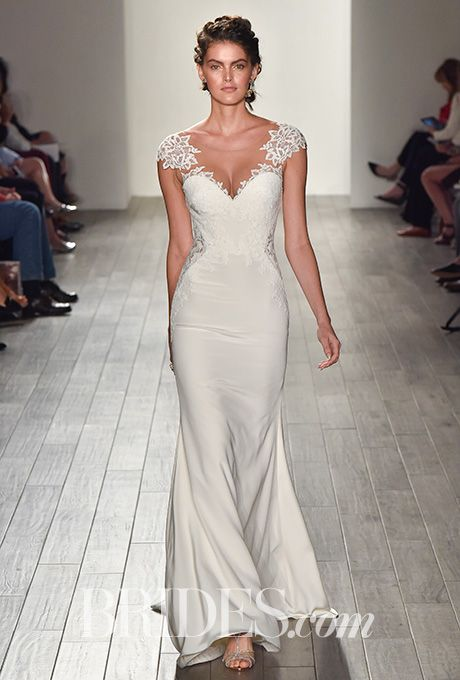 Brides.com: . Style 8701, Ivory crepe sheath wedding dress, lace appliqued illusion V-neckline, sheer lace side cutouts, cap sleeves by Jim Hjelm