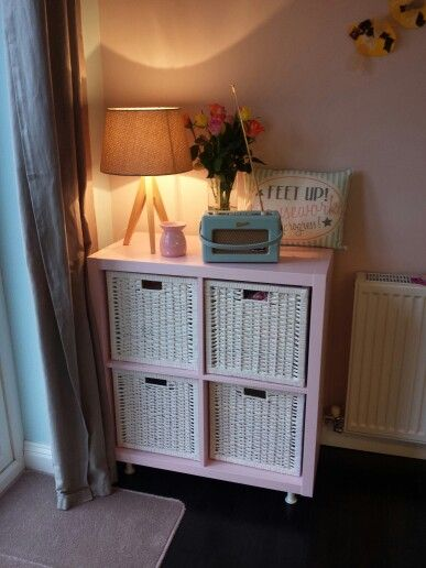 Pink kallax as a laundry basket and sorter