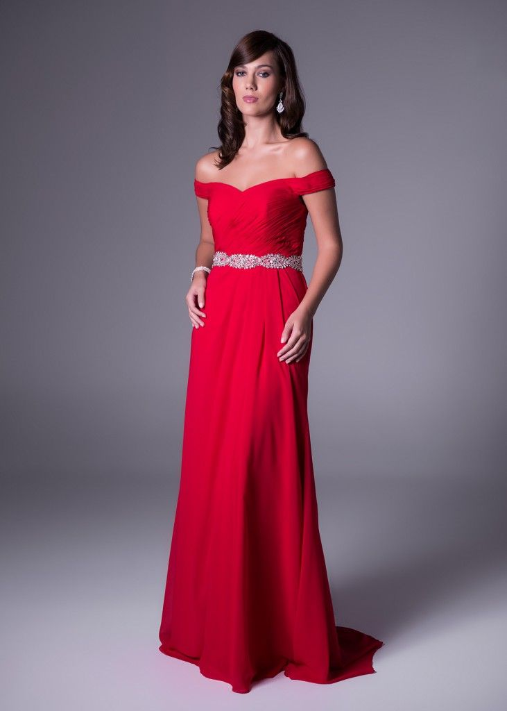 """Stand out like Julia Roberts did in """"that red dress!"""" This exquisite off-the-shoulder dress in Valentia and Ruby colours - with shimmering diamante belt to define your look - can only be found at Bride&co stores. Click to View or Book a Fitting (style VC2845)."""