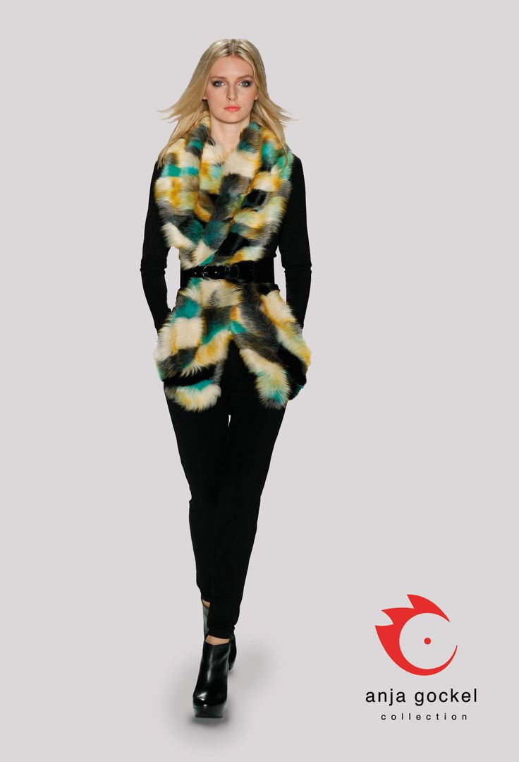 A long-sleeved jumpsuit that is topped by a multicolored fun fur shawl. The black belt accentuates the waistline and makes the outfit even more stunning.