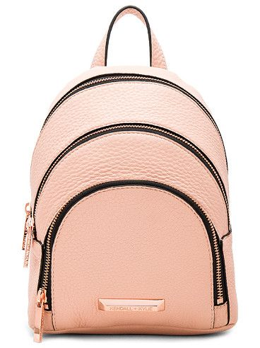 Sloane mini backpack by KENDALL + KYLIE. Leather exterior with suede lining. Zip around closures. Adjustable shoulder straps. Exterior zip pockets. Exterior c...