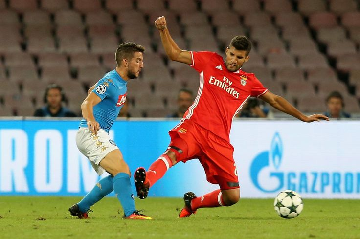 Dries Mertens (L) of Napoli competes for the ball with Lisandro Lopez of Benfica during the UEFA Champions League match between SSC Napoli and Benfica at Stadio San Paolo on September 28, 2016 in Naples, Italy.