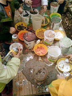 mixing station: flour, ivory snow, corn starch, powdered tempera, salt, sand, shaving cream, vegetable oil, corn syrup, and pitchers of water and vinegar