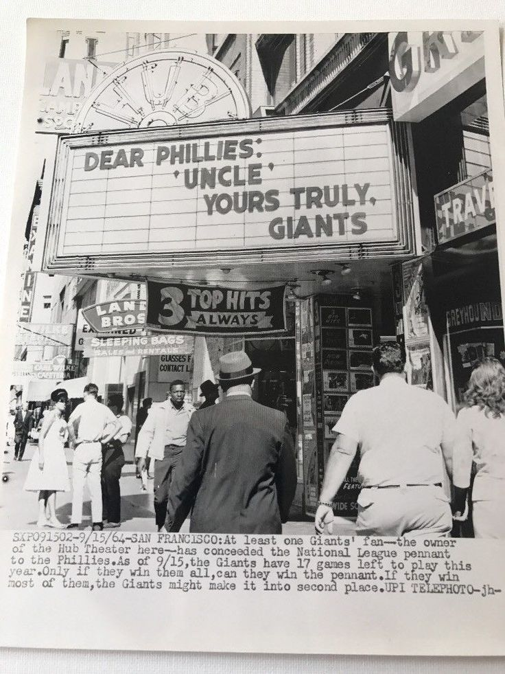 """8""""x9.5"""" vintage telephone/press photo that shows the iconic hub theater in San Francisco with the owners conceding defeat to the Phillies during the the 1964 season. Photo is in good condition. Great piece for any baseball fan. We will ship via Usps 1st class mail. Please let us know if you have any questions. Check out store weekly as we have a large amount of vintage press photos. Baseball 1 
