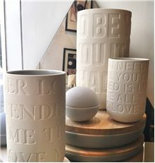 Love Songs vases for Danish Kahler. Comes in three variations each with their own love song embossed into the surface. Raw water cut surface.