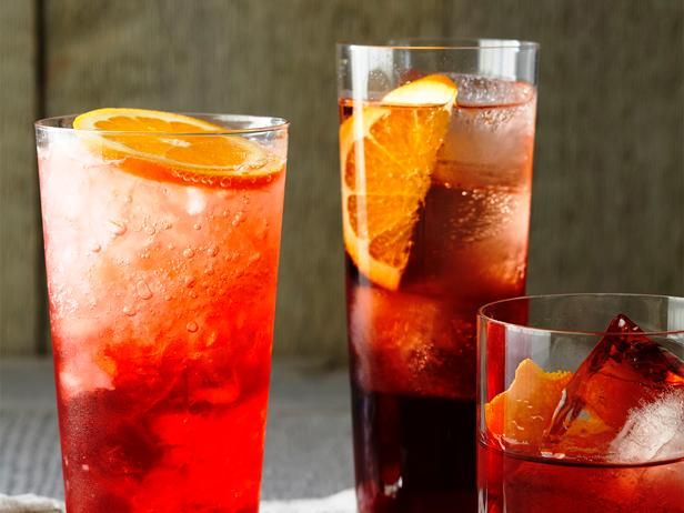 Campari and Soda : Just three ingredients are needed for this colorful cocktail: Campari, seltzer and orange slices.