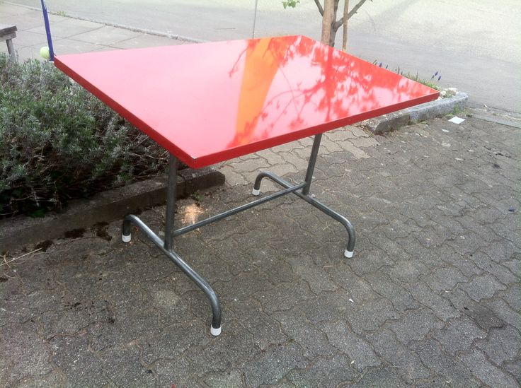 Vintage Swiss garden table with red metal tabletop - durable and timeless.