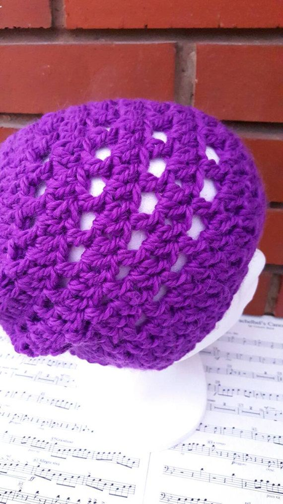 This is a hand crochet hat made in a luxurious wool and alpaca mix yarn. An adult hat, suitable for a large head and very comfortable if you have a lot of hair like me! This colour is a bright and vibrant purple, great for brightening up a dull, cold day. A perfect gift for anyone in your life, or why not treat yourself! The simple crochet beanie design means it this winter hat is suitable for a woman or man. Hand wash only. This is a ready made item and will be dispatched in 1-3 working…