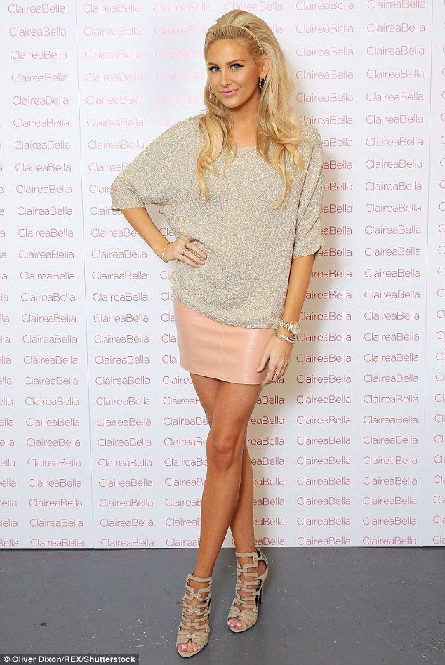 Glam: The US-born star looked fantastic in a nude-coloured skirt and a metallic-flecked jumper