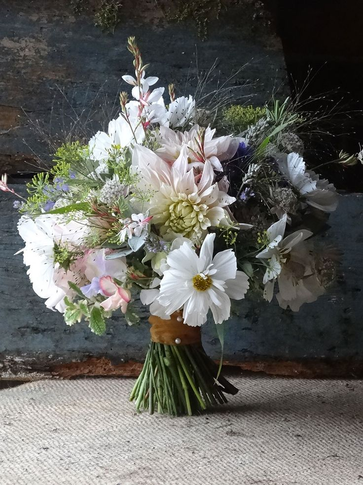A September wedding bouquet of cutting garden flowers by Catkin Flowers. From…