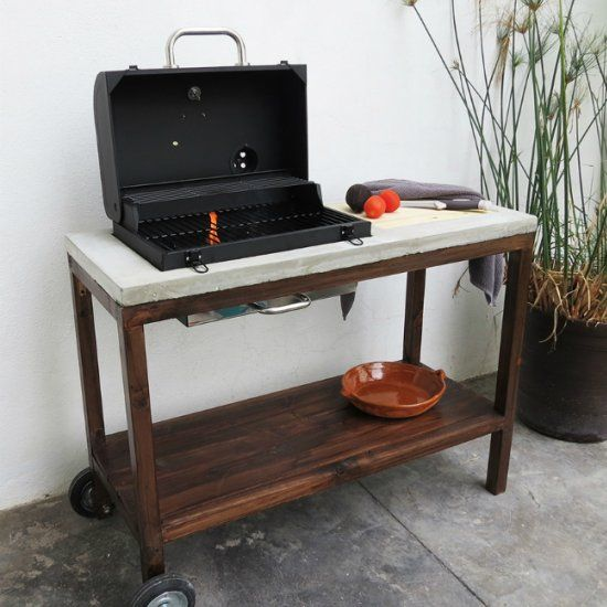 This DIY outdoor kitchen includes a concrete countertop, built-in cutting board…