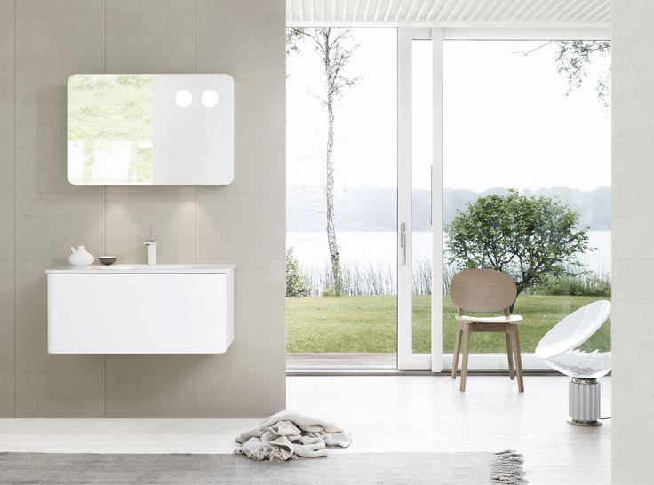 The Dansani Curvo bathroom furniture and mirror cabinet floating in perfect harmony.