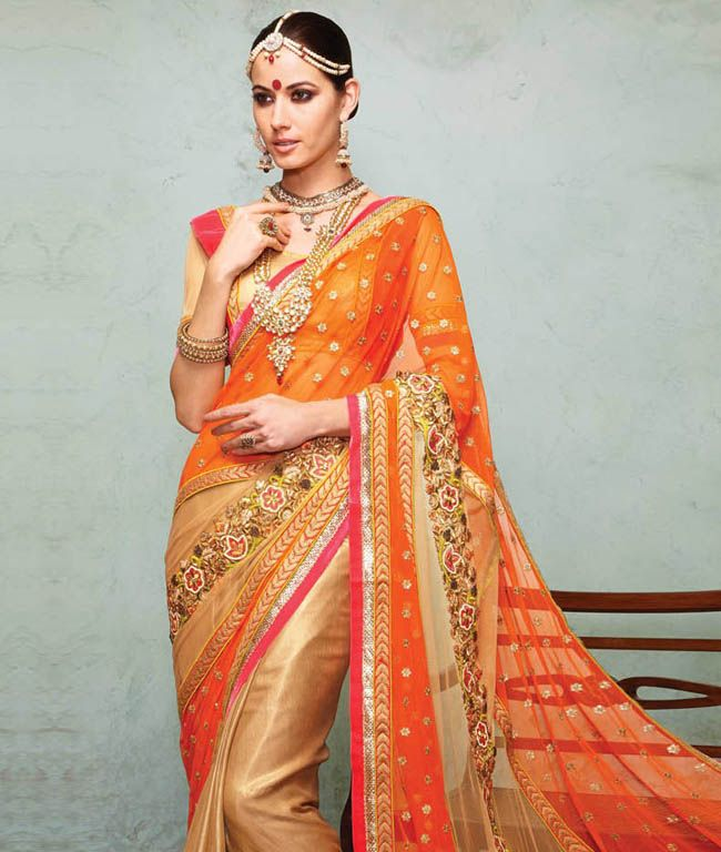 Indulge yourself in this chic collection of sarees that will add richness to your look and lets you give an impression of being like a diva whenever you step out. Get ready for myriad compliments in these occasion wear sarees and be the star of every occasion. Design Highlights: Resham, Zari Embroidery with Stone Work and Lace BorderBRAND: HypnotexCATEGORY: Lehanga Saree with Unstitched BlouseARTICLECOLOURMATERIALLENGTHSareeLight Brown and OrangeSoft Net5.50 metersBlouseGold and PinkVelvet…