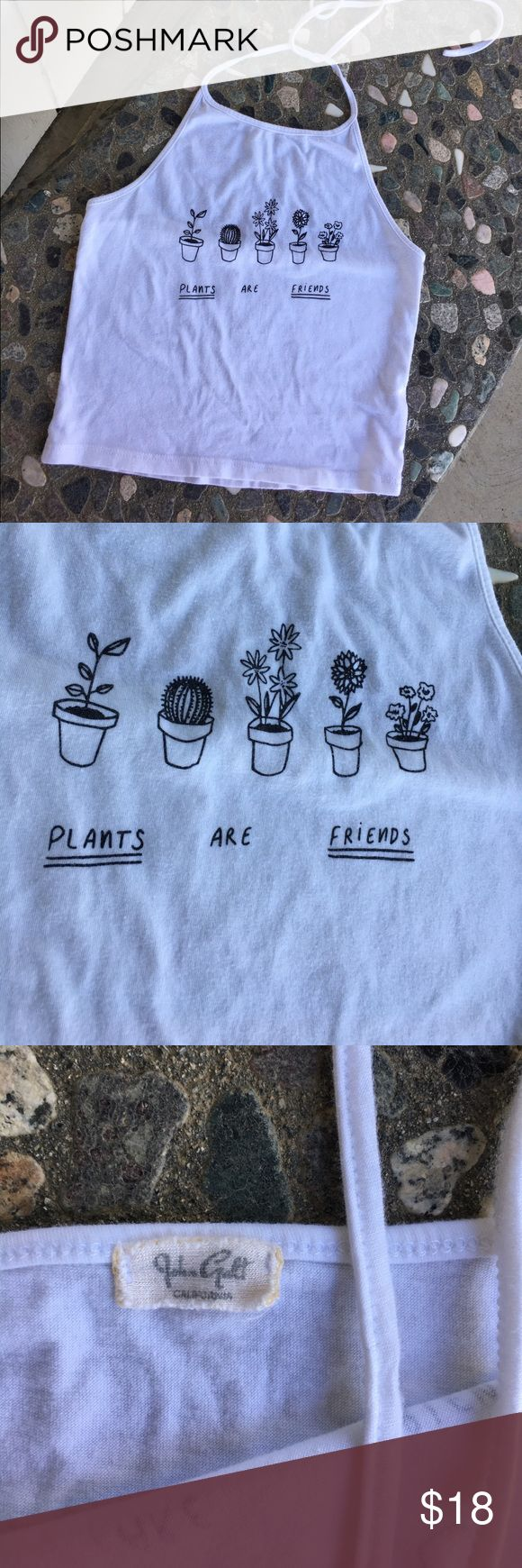 """Brandy Melville """"Plants are friends"""" Halter This top has never been worn or washed. 🌿🌿🌿🌿🌿 This shirt is a tad sheer so keep that in mind when purchasing. 🍒🍒🍒🍒 If you have any questions please feel free to ask. Brandy Melville Tops"""