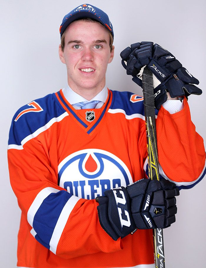 Connor McDavid poses after being selected first overall by the Edmonton Oilers in the first round of the 2015 NHL Draft at BB&T Center on June 26, 2015 in Sunrise, Fla.
