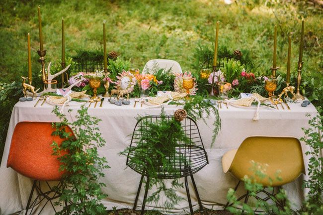 woodsy inspired tablescape with king proteas, rocks, animal figurines and more!
