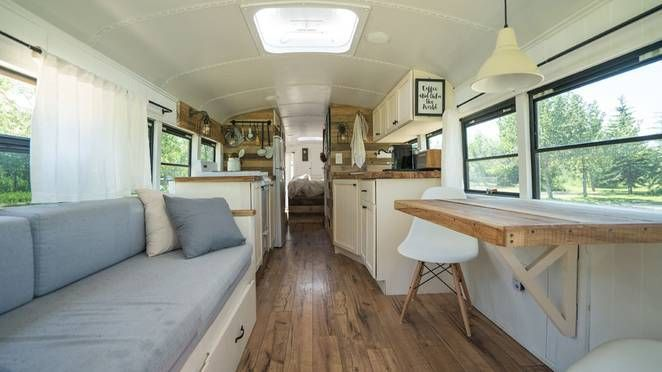 Old school bus converted into loft is traveling from Alaska to South America…