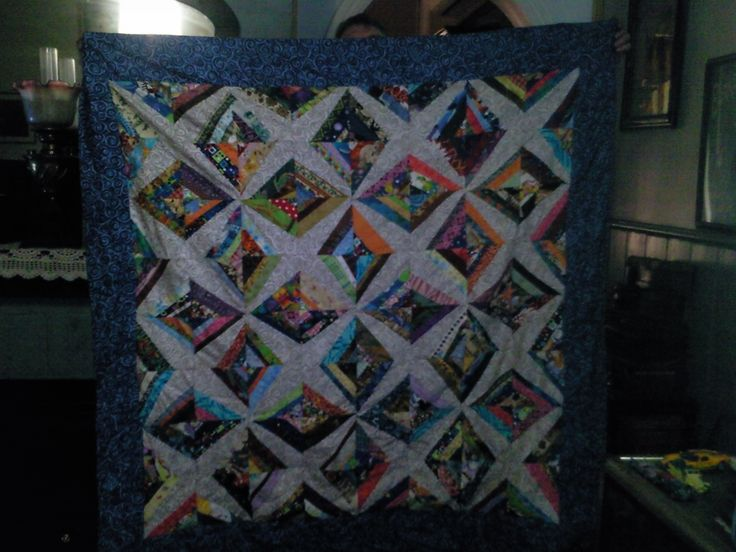 Montana star scrap foundation quilt long term project it is on the chair and is so warm even without batting