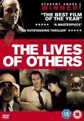 """The Lives of Others"" - ""Das Leben der Anderen"".  Great German movie about an agent of the secret police in East Berlin in 1984 conducting surveillance on a writer and his lover, who finds himself becoming increasingly absorbed by their lives."