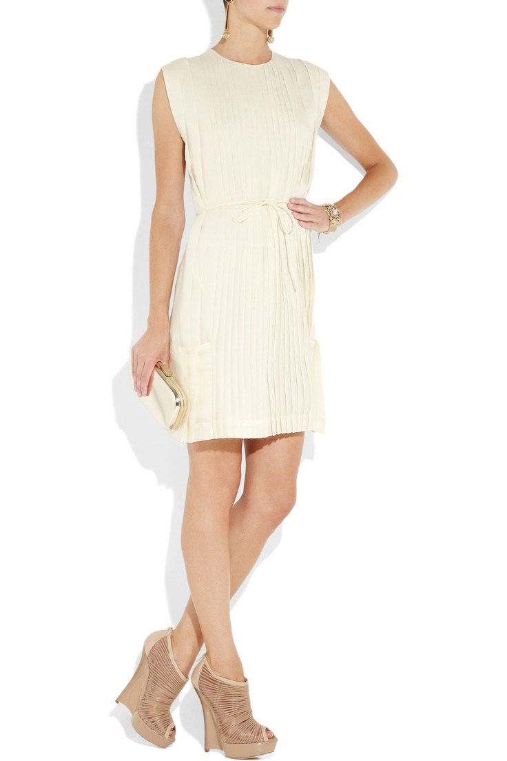 Work tone-on-tone neutrals with a cream dress.  Shown here:  Anya Hindmarch clutch, Valentino bracelet and a Calvin Klein Collection dress.