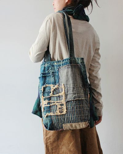 "A tote made from old pieced and re-purposed Japanese textiles -- ""Boro"" textiles. A bit of history: if this bag could talk . . ."