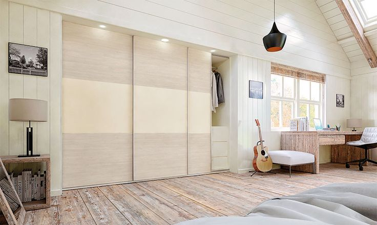 Fitted cream sliding wardrobe. Beautifully designed and elegantly engineered by BA Components.