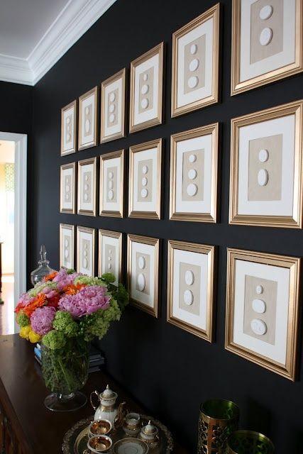 Framed Intaglio's on a black wall.