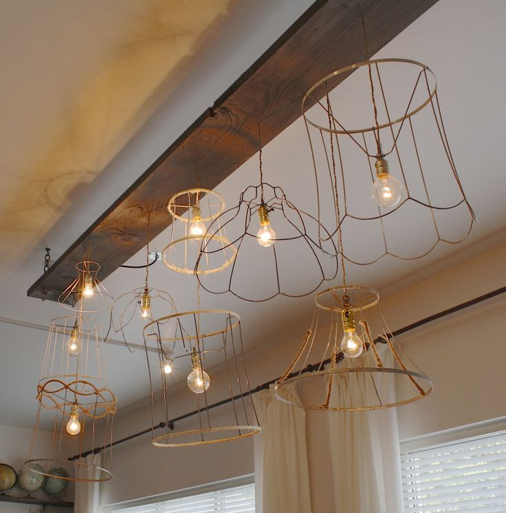 grouping of pendant lights using old lampshade frames