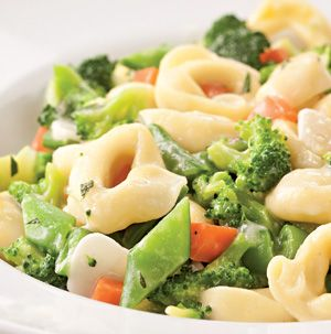 We all know the old trick of adding cheese to vegetables to make the kids eat them, right? Tortellini Primavera goes 1 step farther - add cheese-filled pasta! Works like a charm.