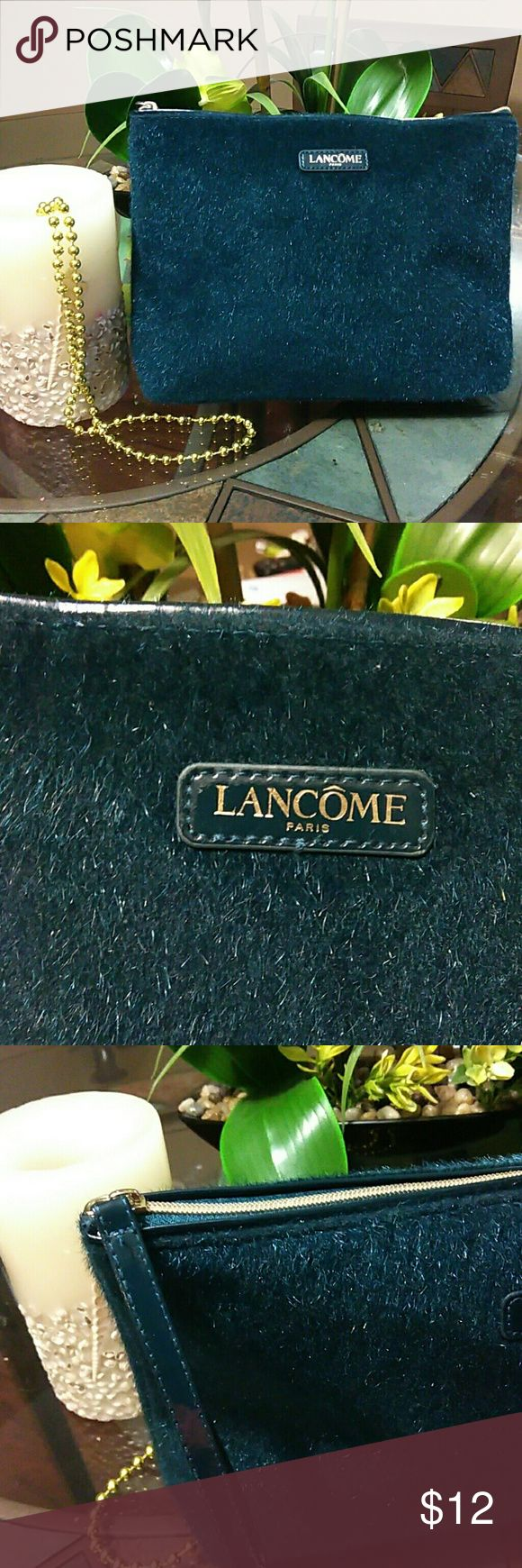 NWOT Lancome Paris Designer Cosmetic Bag This bag is a great piece for travel or everyday essentials. Features Faux fur, gold tone hardware, zip closure, patent leather finish at the bottom and the strap. Measures 11.5w x 8h x 2.5 at the bottom. A must have. Lancome Bags Cosmetic Bags & Cases