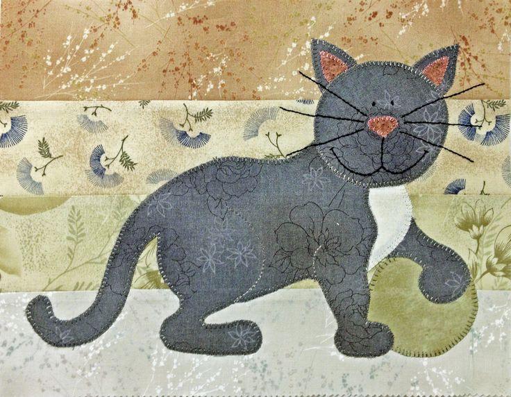 Lapptäcke sytt av jellyroll, med applicerade katter - detalj