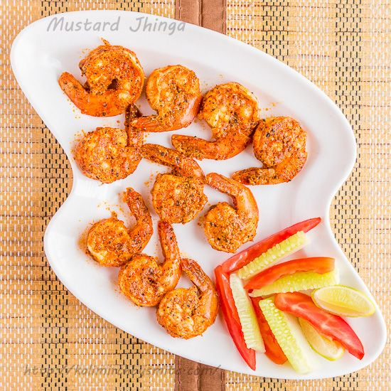 Tandoori Prawns is a simple tandoor recipe with very few ingredients required. The stand out point for this recipe is use of mustard. Succulent prawns with its sweet juices cooked till perfection and twist of mustard imparts a slight pungent kick and one that is required to take this recipe to the next level.
