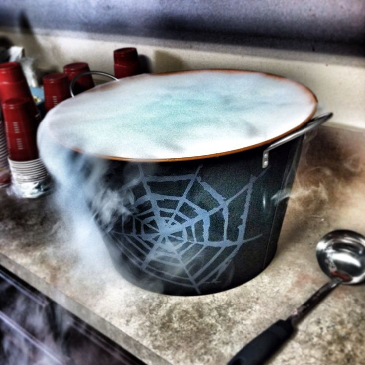 """""""Witches Brew"""" Halloween Adult Party Punch with dry ice... 2 gallons Hawaiian punch, 3 cans pineapple juice, 1 bottle everclear,  1 bottle vodka, 1 bottle Malibu rum (and 8 lb block of dry ice) Be careful! You can't taste the alcohol!! ;)"""