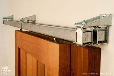 Bypass rail system allows for up to 4 doors on the tracks. Box Rail Bypass  Barn Door Hardware