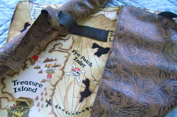 Give your little one the secret to finding the pirates treasure! This treasure map is made from washable fabrics with one side resembling engraved leather. Roll it up and secure with the attached tie. The map measures 8 1/2 x 13. *Maps may not come in landscape orientation as shown in
