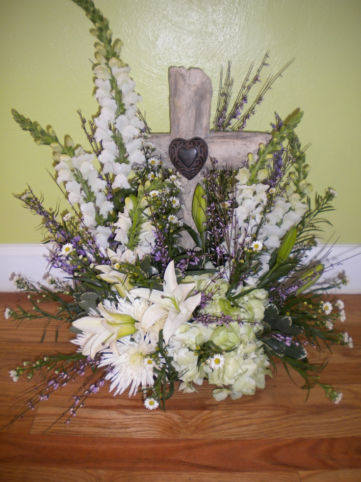 The flowers for Todd Sporleder at Reeb's on Thursday were beautiful. You made 3 arrangements for my family using the cross, candle and book I brought to you. Several people commented on how nice they were. I especially liked the one with the candle. Thank you again, Judy Jones