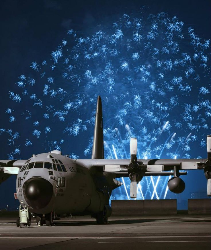 Yokota AB, Japan, Independence Day Celebration 2015 ~ USAF Week in Photos (Fireworks explode behind a C-130 Hercules during Celebrate America, July 2, 2015, at Yokota Air Base, Japan. Celebrate America is an annual event that provides military members and their families the opportunity to enjoy games, food and bands before culminating in a fireworks display to celebrate Independence Day. (U.S. Air Force photo by Airman 1st Class Delano Scott/Released))