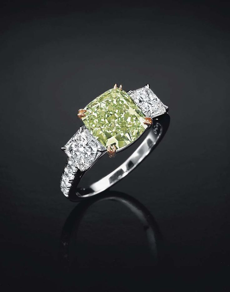 Lot 197, a rare coloured diamond and diamond ring in platinum and rose gold, set with a modified square-cut fancy intense green diamond weighing approximately 3.60ct (estimate: US$800,000-1.2 million).