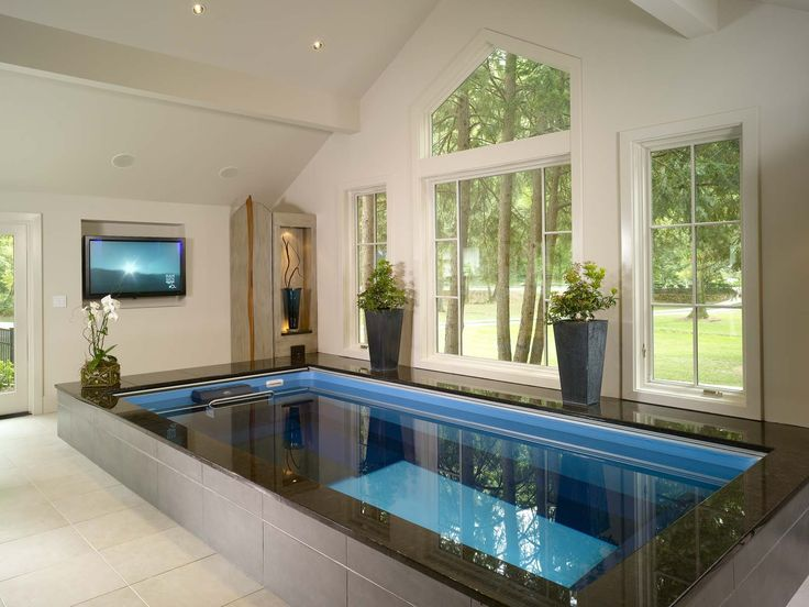 Indoor Home Pool Designs beautiful pendant lights and simple rectangular indoor swimming pool design feat plantation idea Endless Pool In A Home Spa Infused With A Relaxing Setting Of Art Music And