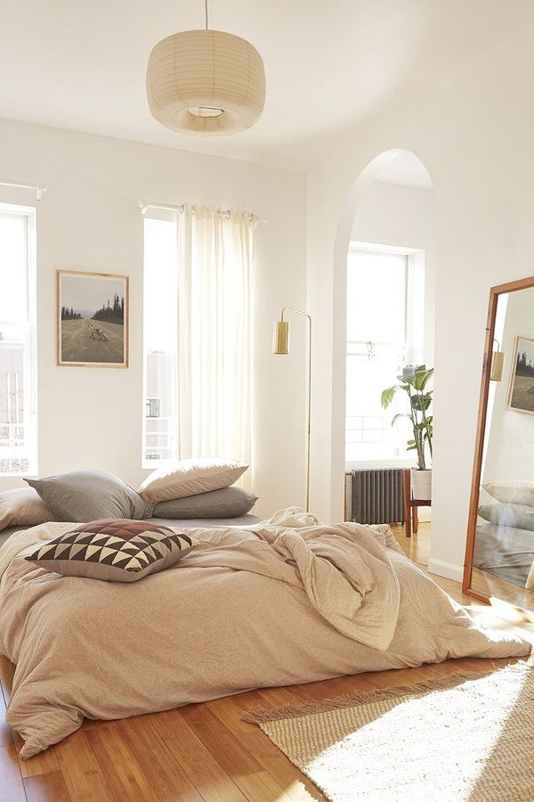 Lovely light and airy bedroom, I love the high ceilings, floor mirror etc.  On the bed is a Heathered Jersey Duvet Cover with a pile of throw pillows for that comfy and cozy look.